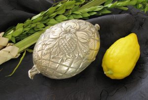 Etrog, silver etrog box & lulav used to celebrate Sukkot.